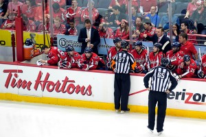 Referee Eric Furlatt addresses the Capitals' bench