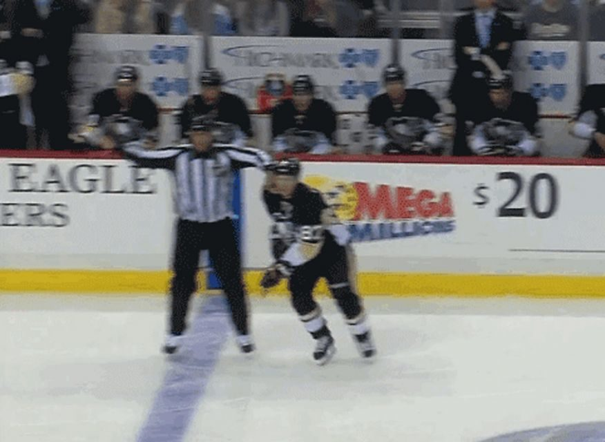 Linesman Takes Out Pens' Crosby