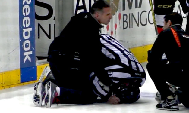 Linesman Steve Miller Injured on Faceoff
