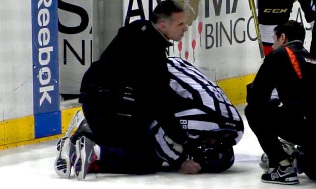 Linesman Steve Miller Injured on Faceoff
