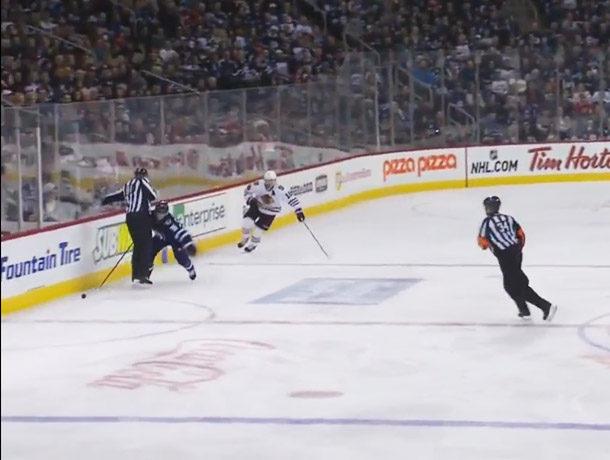 Jets Enstrom Loses Stick Behind Linesman, Hawks Score