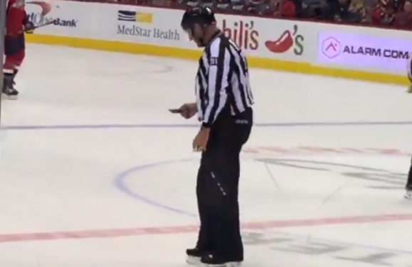 Linesman Cleans Up After Caps' Jumbotron Hit By Puck