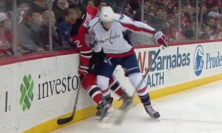 Devils' Moore Hit From Behind By Caps' Wilson