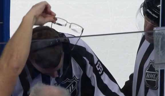 Fan Offers Glasses to Linesman During Offside Review