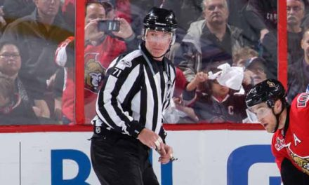 Linesman Brad Kovachik Catches Puck Off Glass