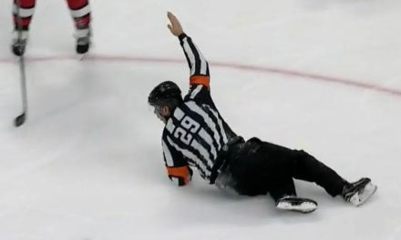NHL Referee Makes Call While Falling to Ice