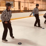 Tim Peel Ref Camp 2019 - Campers work on their puck drop technique by dropping pucks into ringette rings
